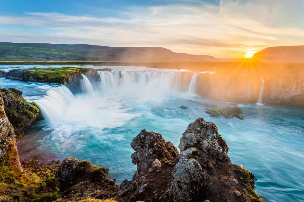 Godafoss waterfall at sunset in summer - one of the best times to visit Iceland