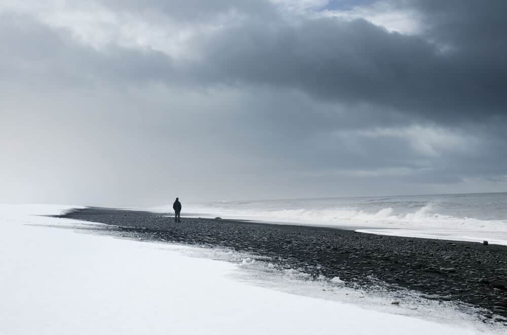 black beach and snow which usually falls in Iceland in february