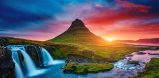 Kirkjufell volcano at sunset in Iceland with waterfall