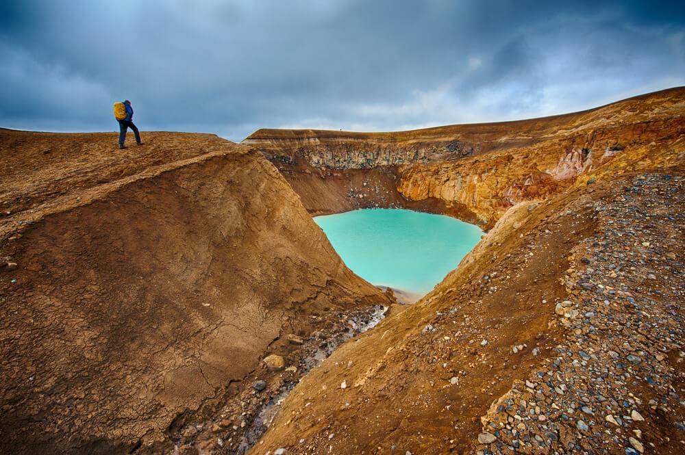 yellowish icelandic volcano caldera with water in it