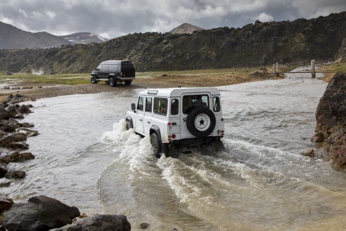 4x4 vehicle fording rivers in the highlands of Iceland