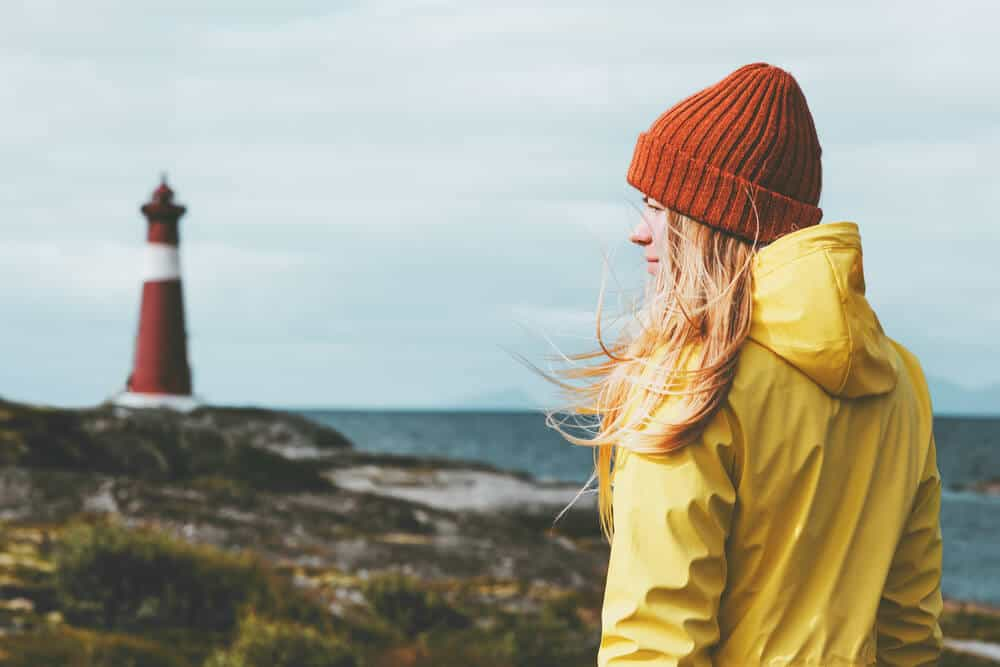 Girl wearing a raincoat which is a must in this packing list Iceland
