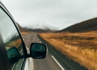 View from the side of a camper on a road trip