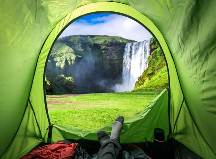 Camping in Iceland in June with a view of a waterfall