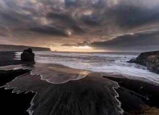 Volcanic black sand beaches near the seaside town of Vík