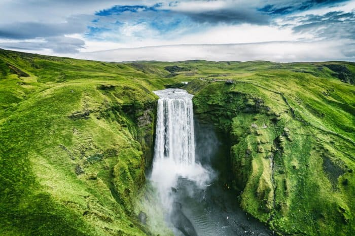 Typical Icelandic waterfall, one of the many nature wonders that suffer the tourism in Iceland pros and cons