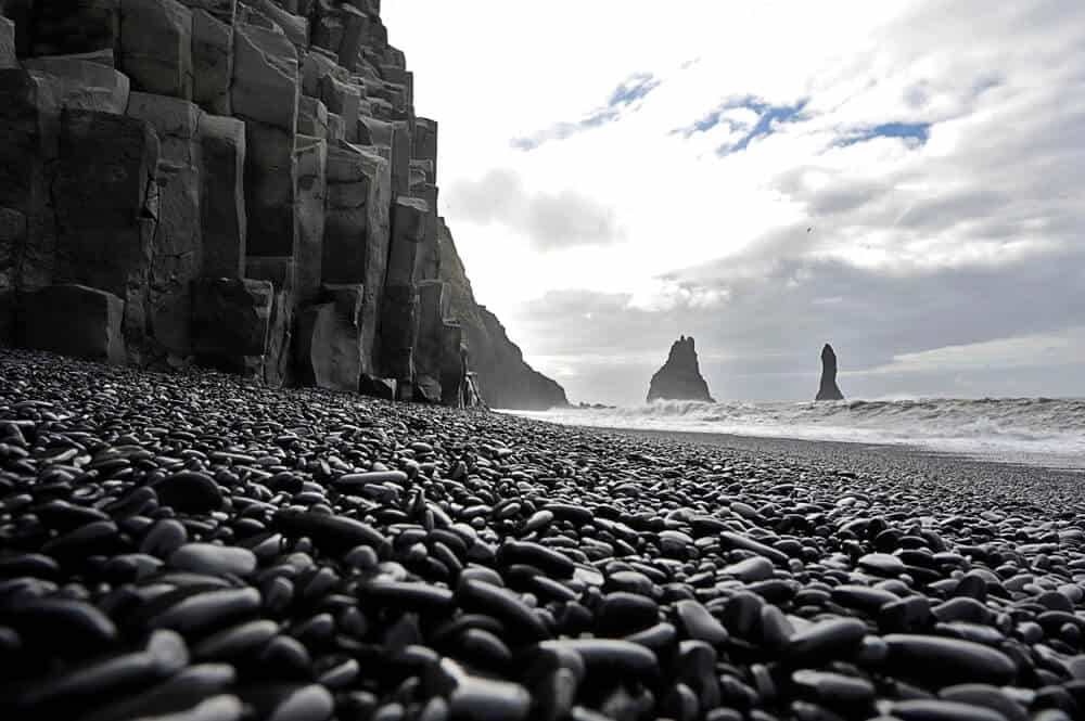 Vik is known for its black sand beaches and basalt columns