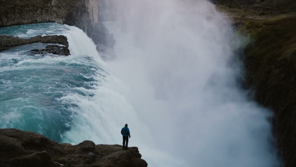 Man standing at Godafoss, one of the best waterfalls in Iceland