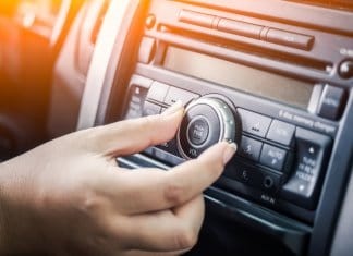 Woman turning up her playlist for best road trip songs