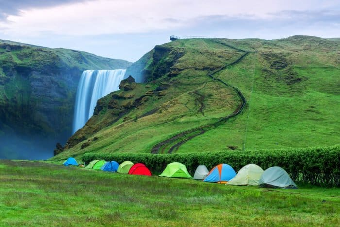 Tents set up in designated camping area at Skógafoss waterfall campsite