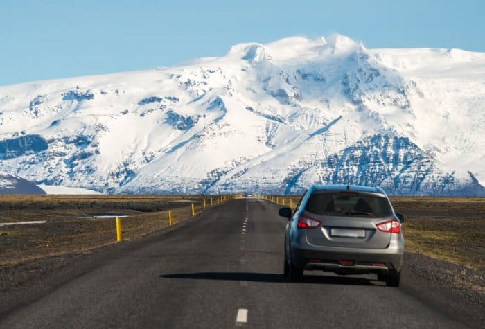 Car driving on Iceland's Ring Road towards mountains. How long does it take?