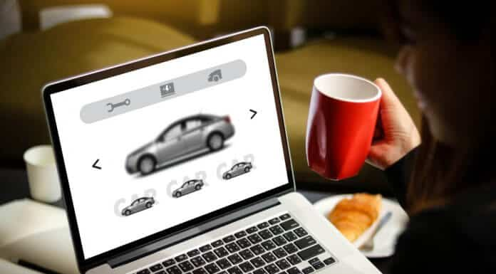 Woman searching for best Iceland car rental on laptop