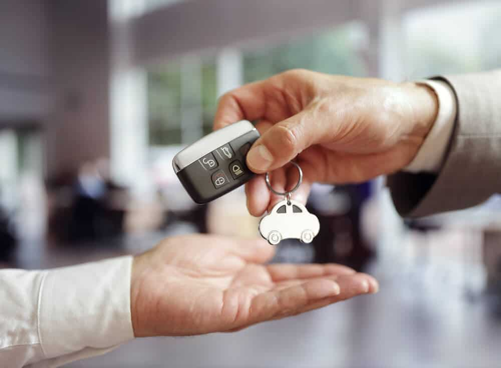 Driver receiving the keys to their Iceland car rental at Keflavik Airport