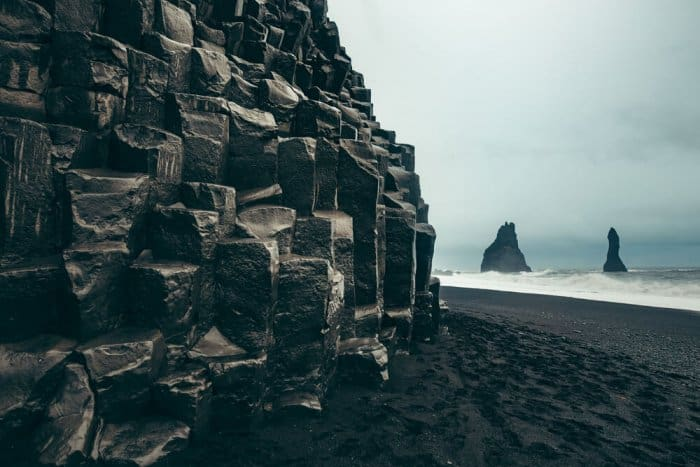 Reynisfjara peninsula and Vik's black sand beaches are popular attractions in South Iceland
