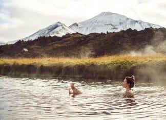 Woman soaking at an Icelandic geothermal hot pot