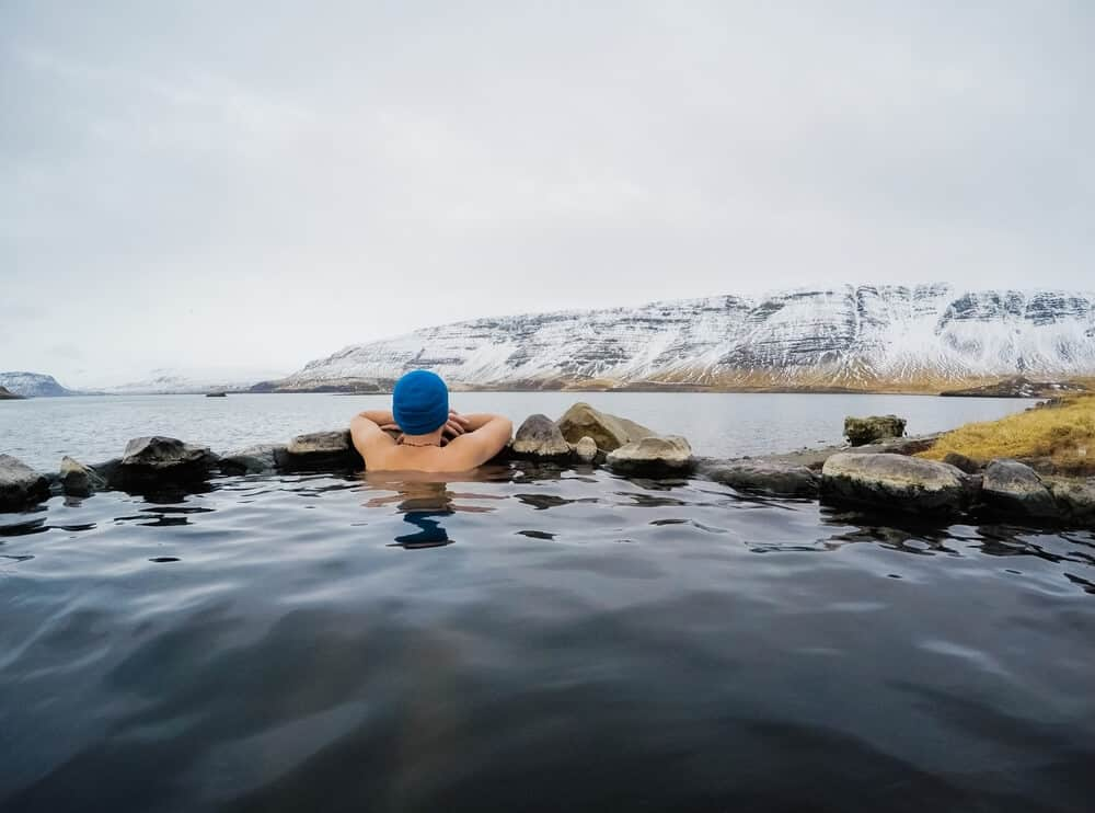 Taking a dip in a geothermal pool is a great winter activity in Iceland