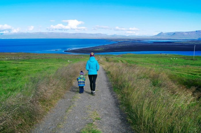 Mother and son walk during Iceland family vacation