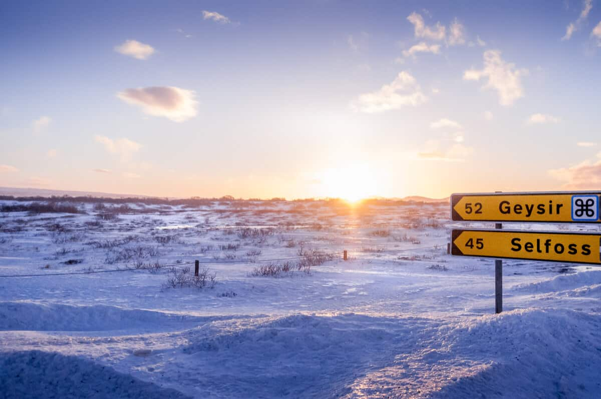 Road signs during Iceland in February with snowy landscapes