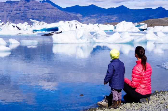 Mom and daugther enjoying view of Jökulsárlón glacier lagoon