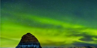 Iceland's Northern Lights over Kirkjufell mountain in winter