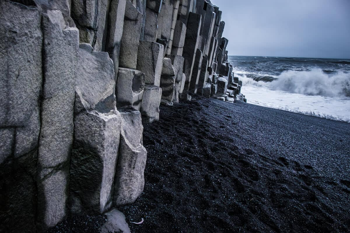 Basalt columns and jointed rock formations at Iceland's black sand beach