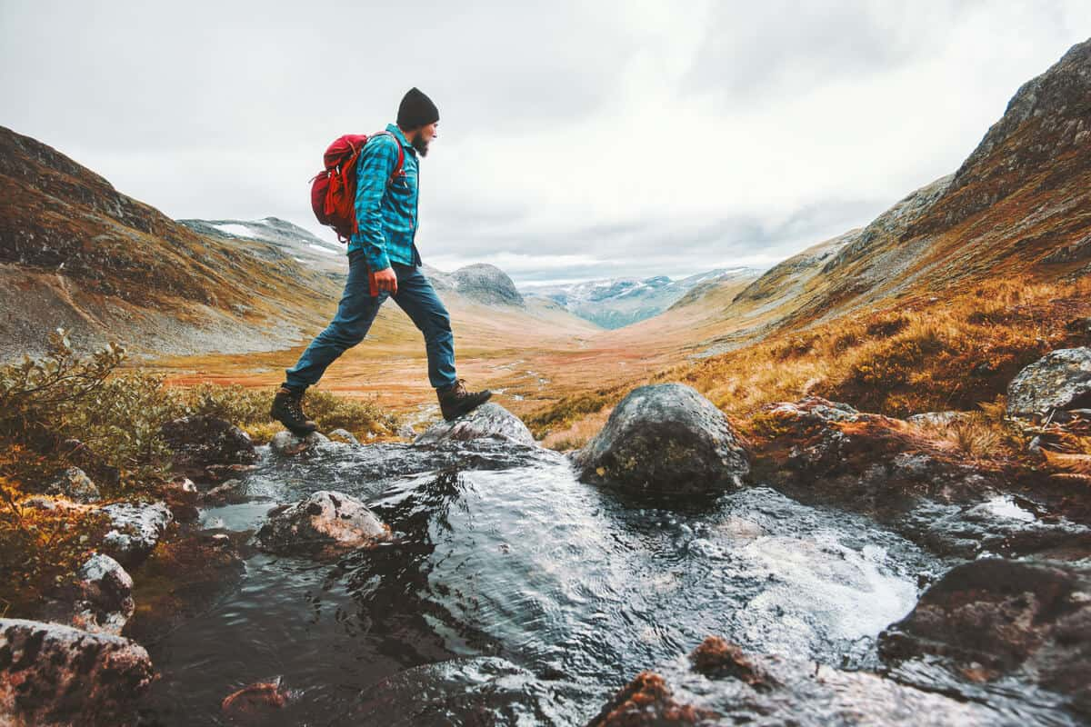 Iceland solo travel man backpackpacking across Landmannalaugar