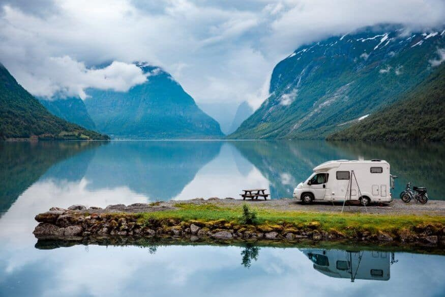 Sapphire lake with campervan during trip while camping in Iceland in November