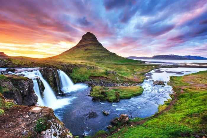Kirkjufell mountain and Kirkjufellsfoss waterfall at sunset are one of Iceland's best photography locations