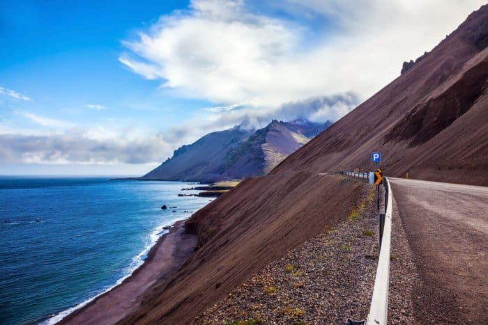 July road with sea in Iceland