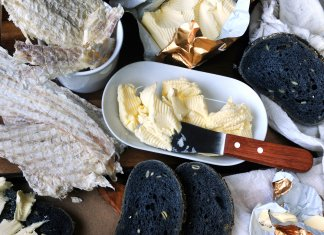 Table spread with Icelandic Hardfiskur and charcoal bread with butter