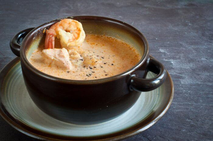 Typical Icelandic salmon soup with shrimp