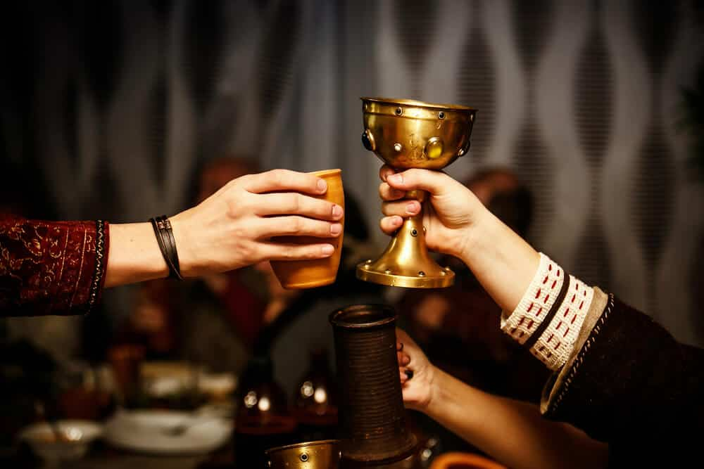 Medieval toast with cups at Icelandic festival