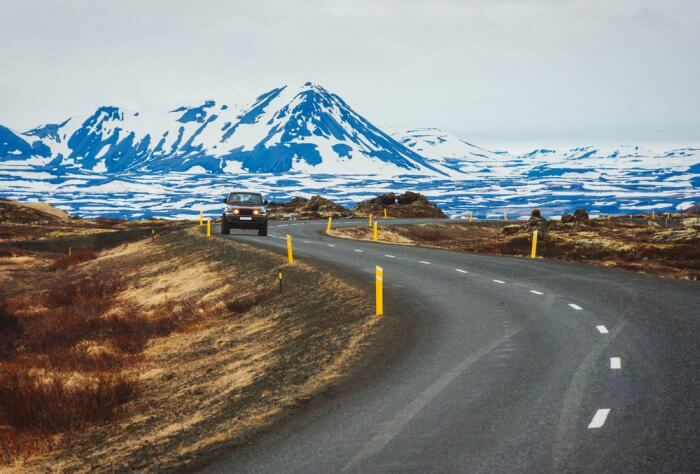 Ring road with some snowed peaks on the background