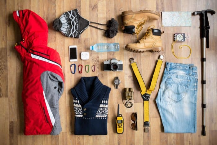 Flatlay of items on summer packing list for Iceland