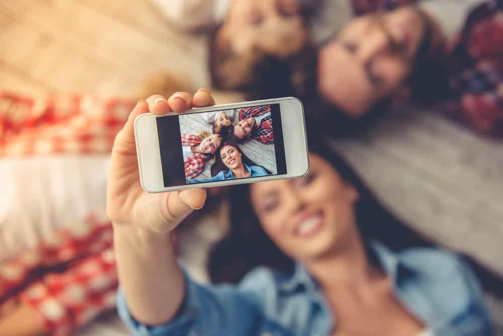Family taking selfies in Iceland for Instagram