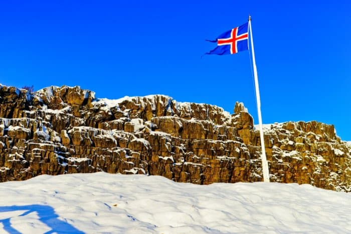Flag of Iceland waiving at the point where the parliament was set in Thingvellir National Park