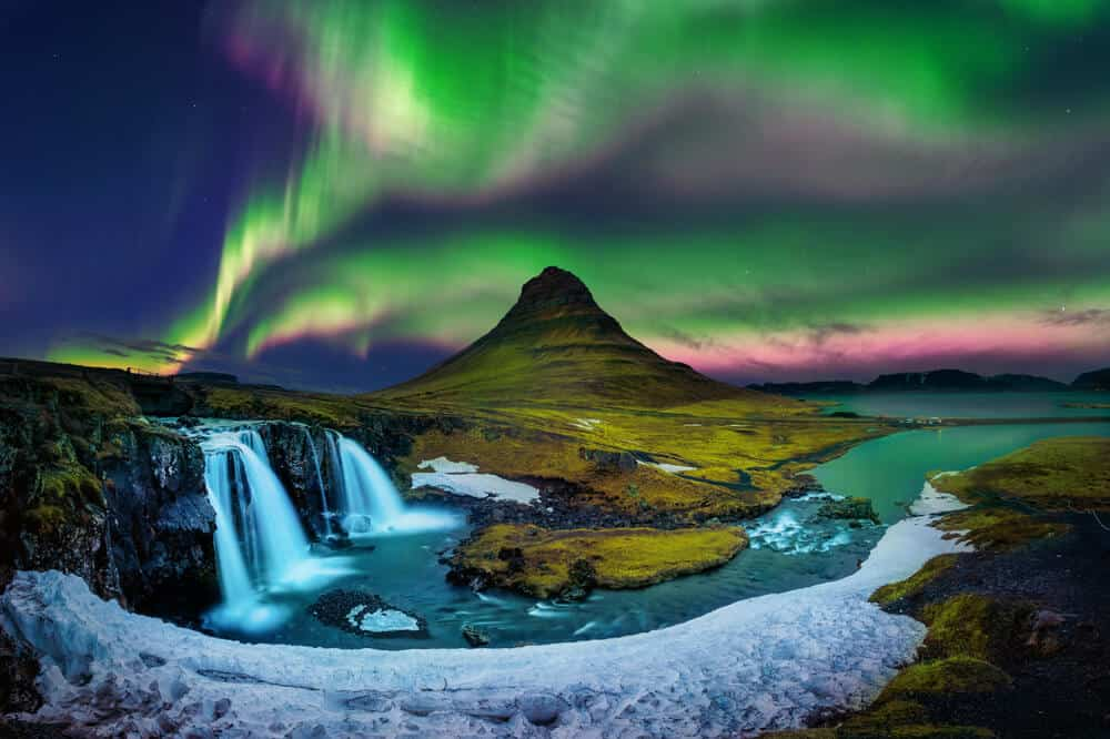 Vibrant hues of green and purple light up the fall sky in Iceland