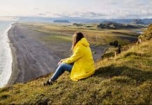 Girl checking the scenery in the mild Iceland weather in August