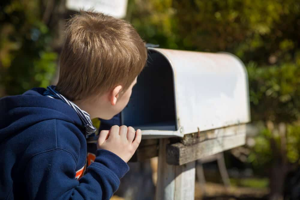 Little boy checking the mail for his family's Iceland Campingcard