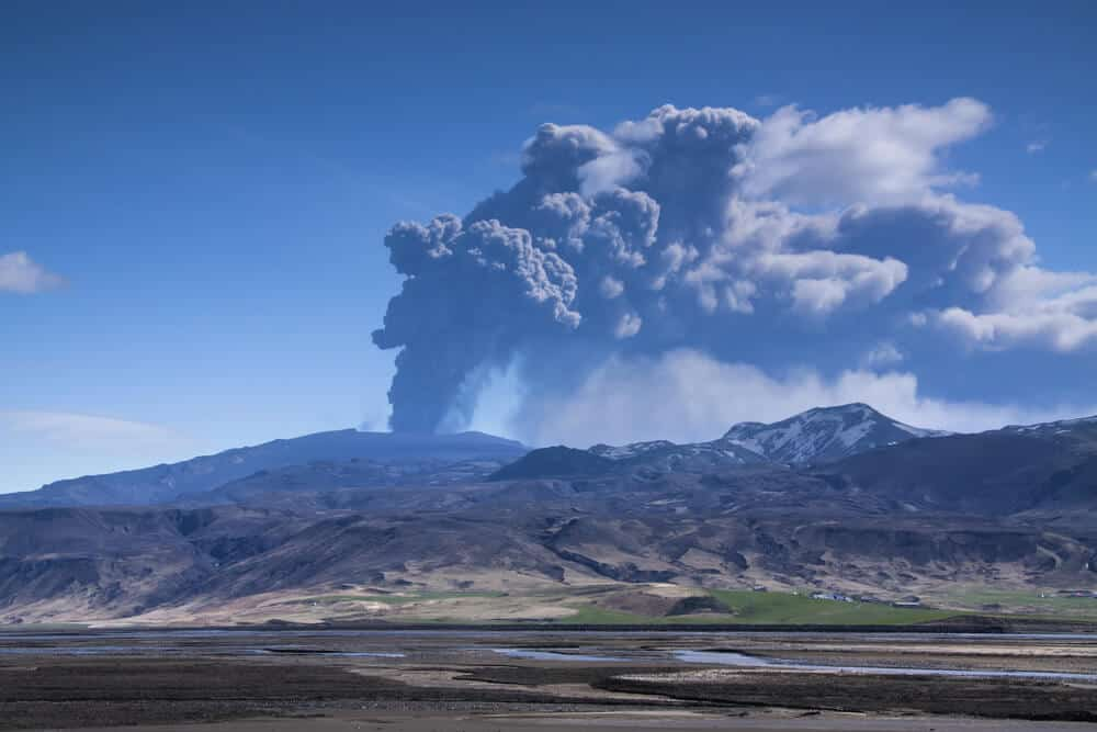 Volcanic eruption leaving a lot of ash in the air and on the ground