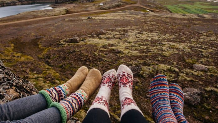 Friends with wool socks on Iceland camping trip