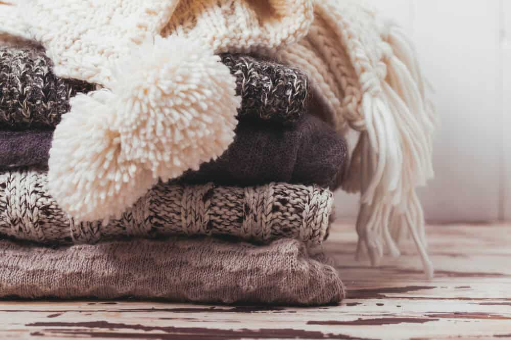 Pile of knit wool clothing for winter in Iceland