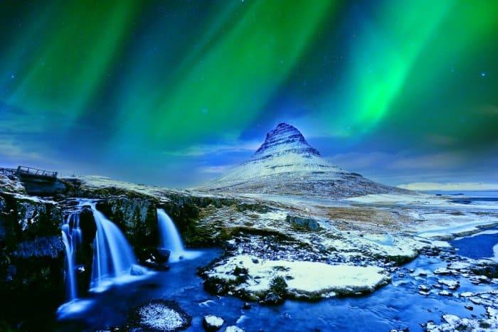 Northern Lights on Iceland's Kirkjufell mountain and Kirkjufellsfoss waterfall in Snaefellsnes peninsula