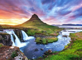 Kirkjufell mountain in Snaefellsnes peninsula with colorful sunset sky