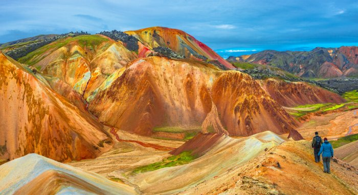 Hikers in Landmannalaugar in awe of the colorful rhyolite mountains