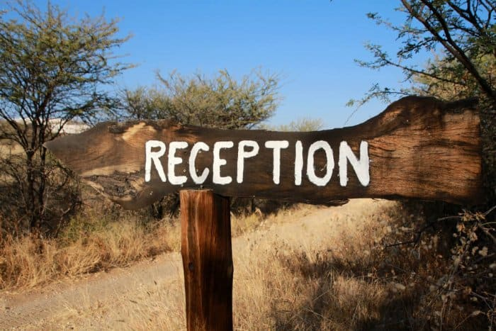 Wooden reception sign at check-in