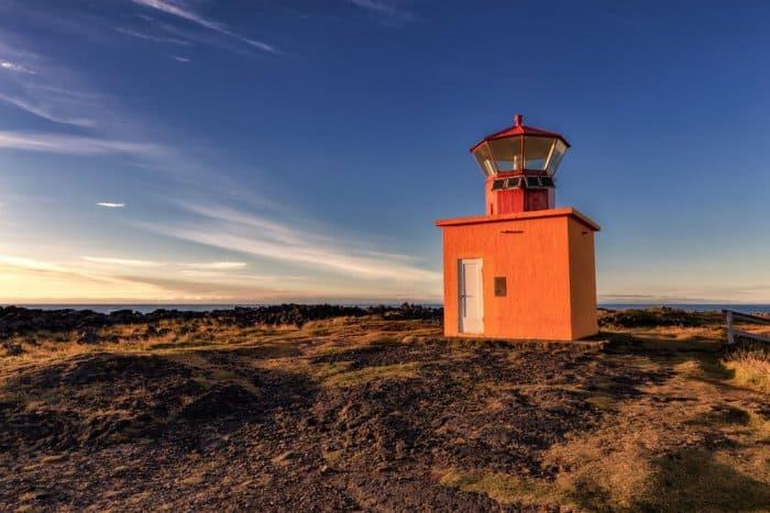 Famous orange Svörtuloft lighthouse in the Snaefellsnes peninsula