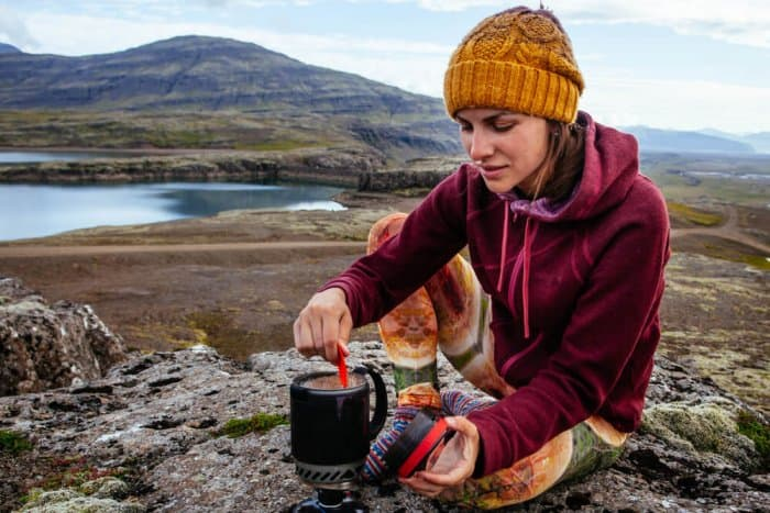 Young woman camping in Iceland