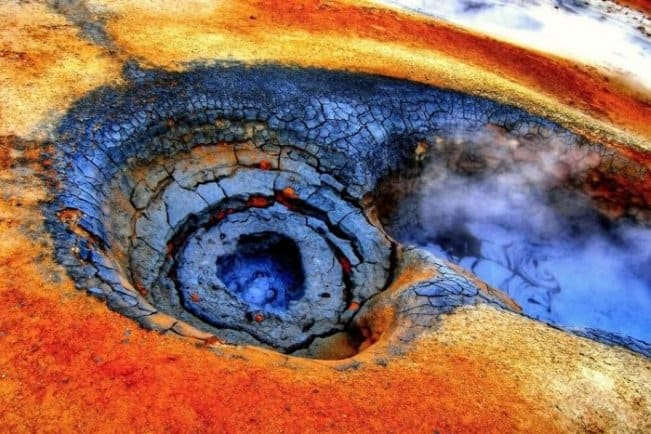 Bubbling blue mud and red earth in Hverir geothermal area is one of Iceland's major attractions