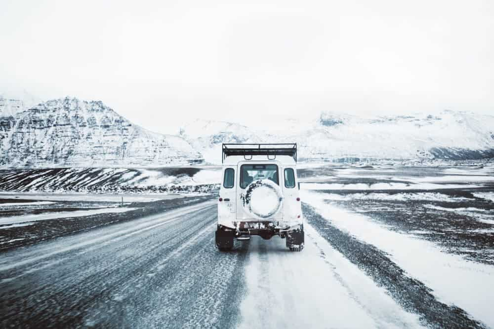 A jeep rental covered by insurance on an icy Iceland road